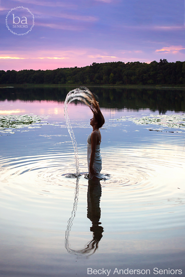 amazing sunset with a water hair flip senior picture