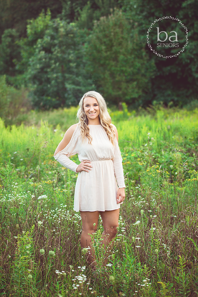 Beautiful PCHS senior in a field of flowers