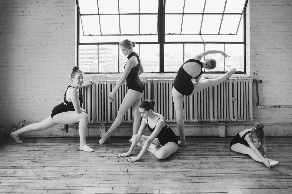 Black tutu squad at the barre