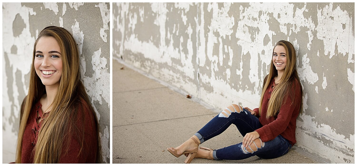 Downtown Kalamazoo otsego senior girl sitting against rustic wall